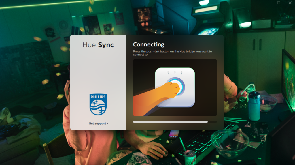 image of press center button of bridge to connect to hue sync